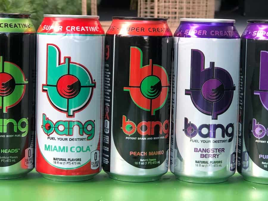 Multiple flavors of Bang on a gree table.