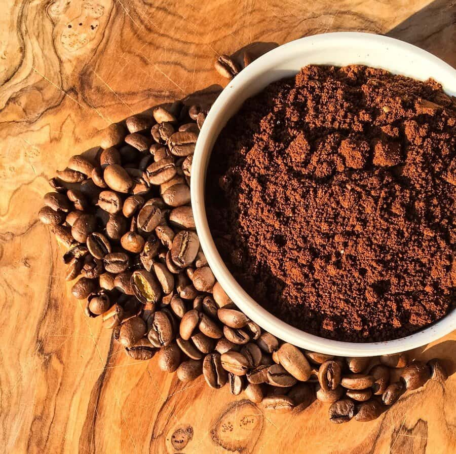 Ground coffee powder and coffee beans.