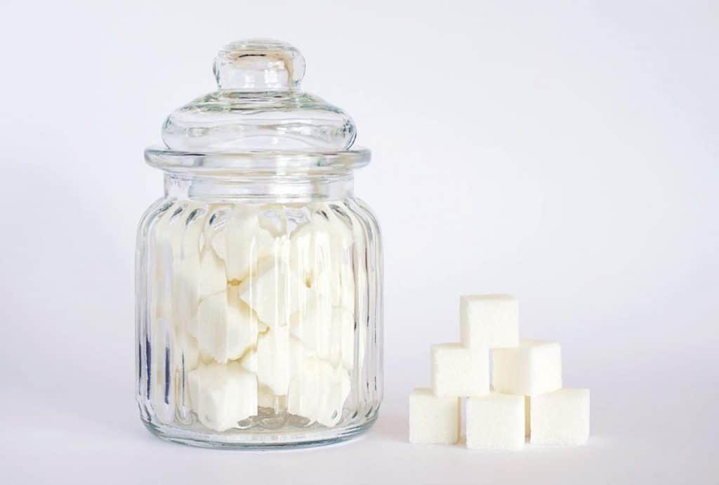 A jar full of sugar cubes