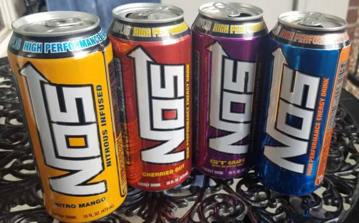 A picture of four cans of NOS Energy Drink