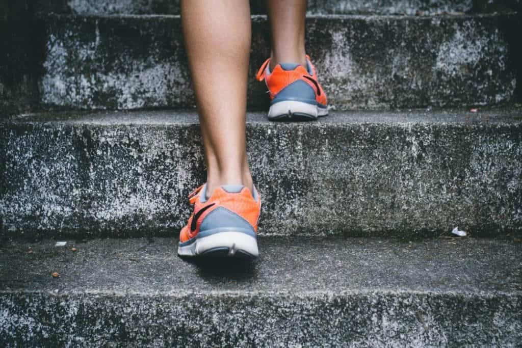 A picture of feet running up steps