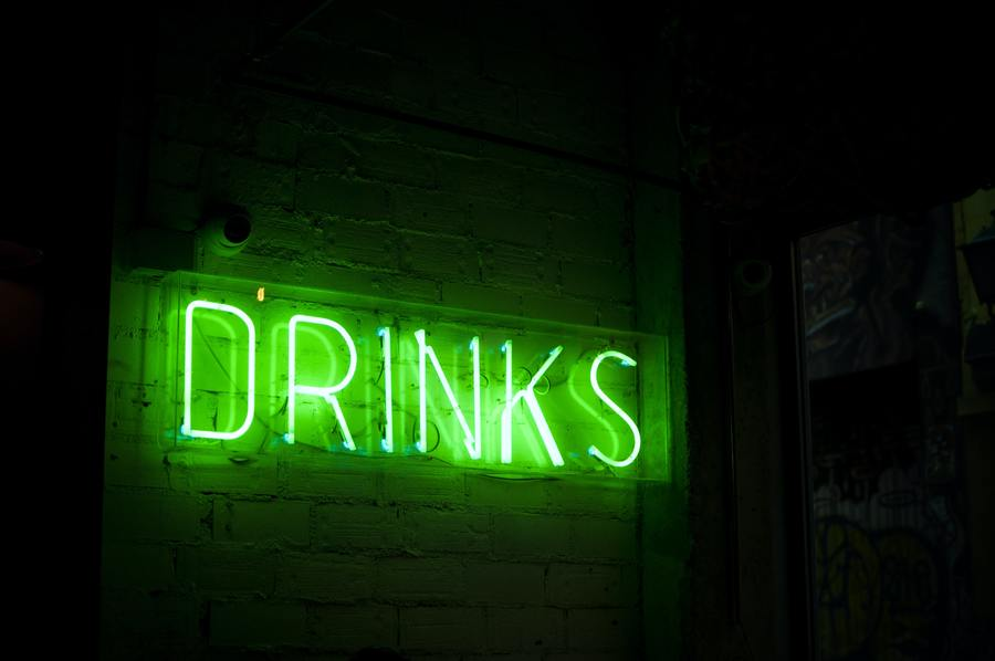 drinks sign in neon green