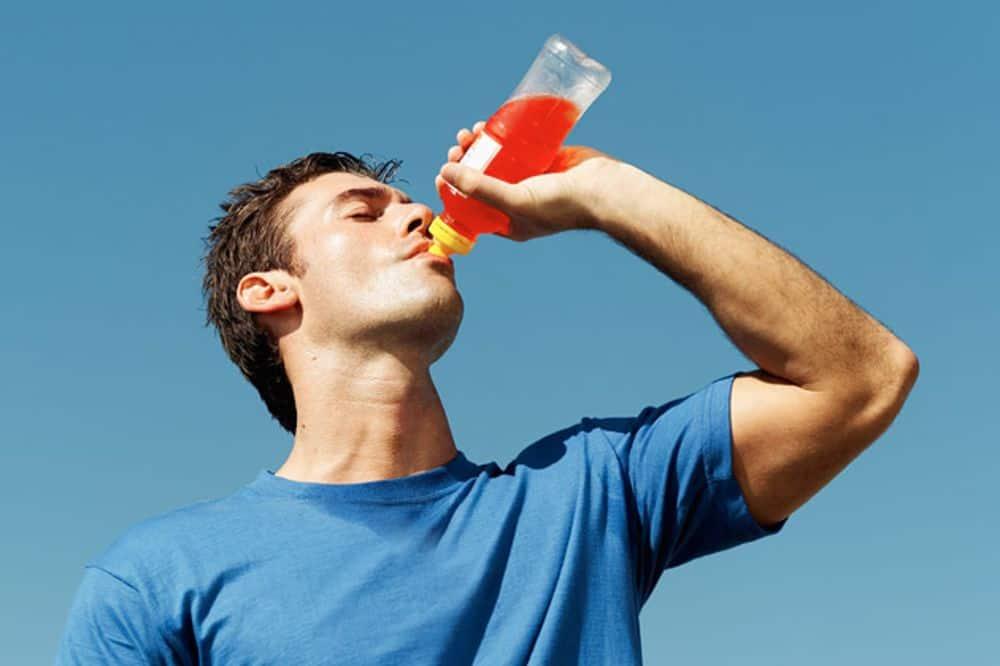 Guy drinking sports drink