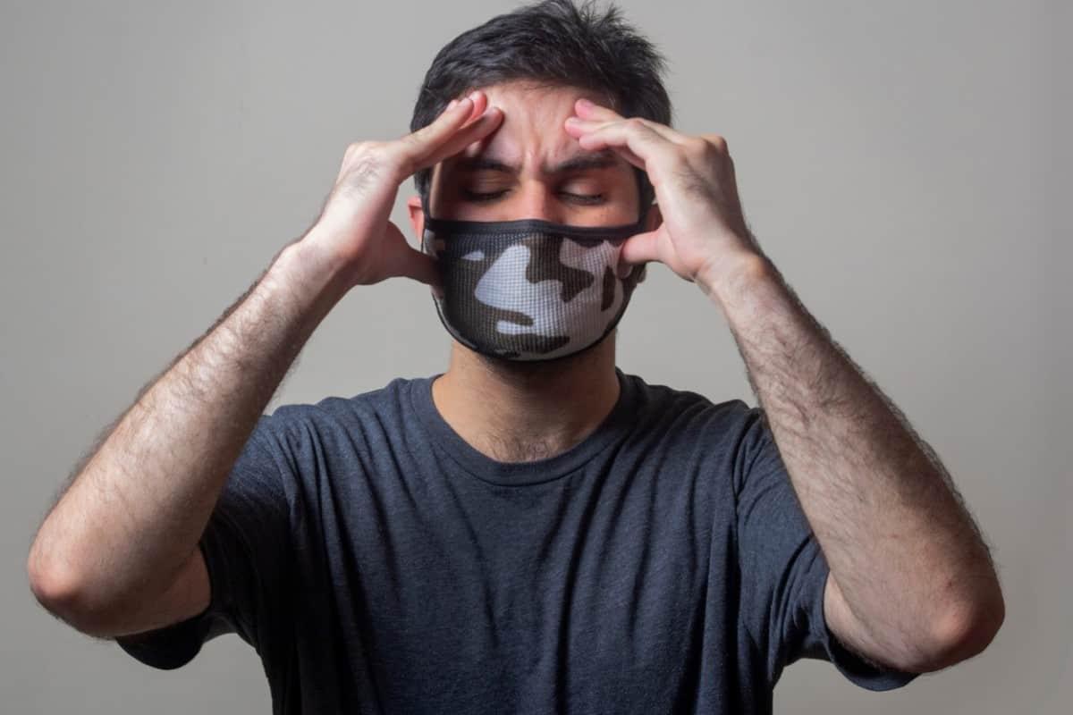 Guy having a terrible headache