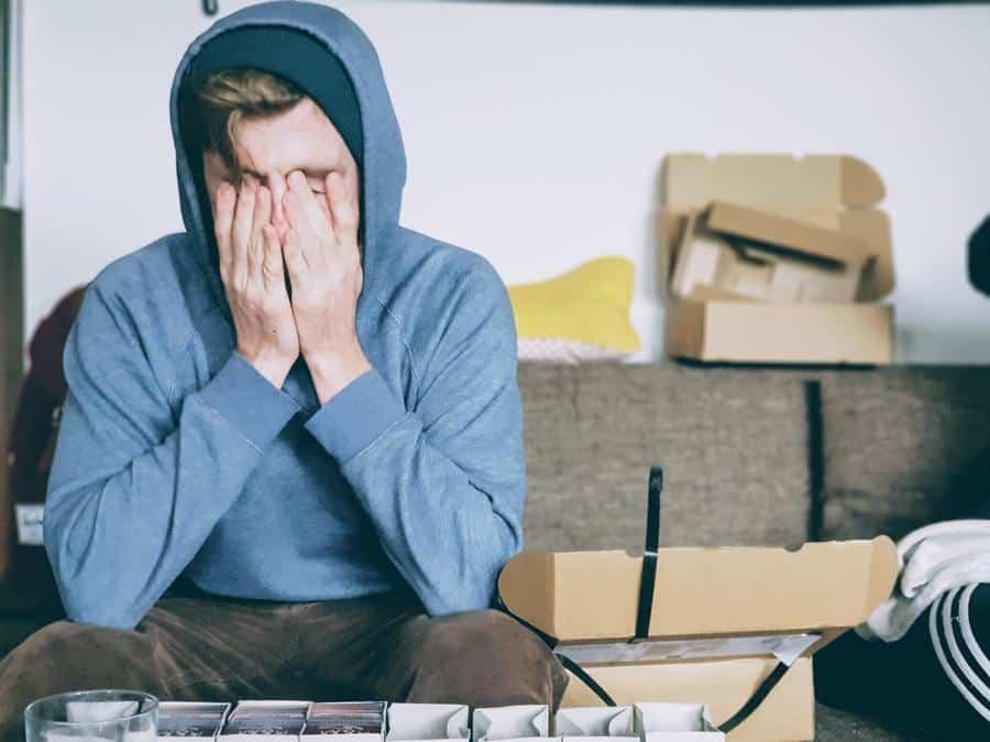 Guy in a blue hoodie looking tired