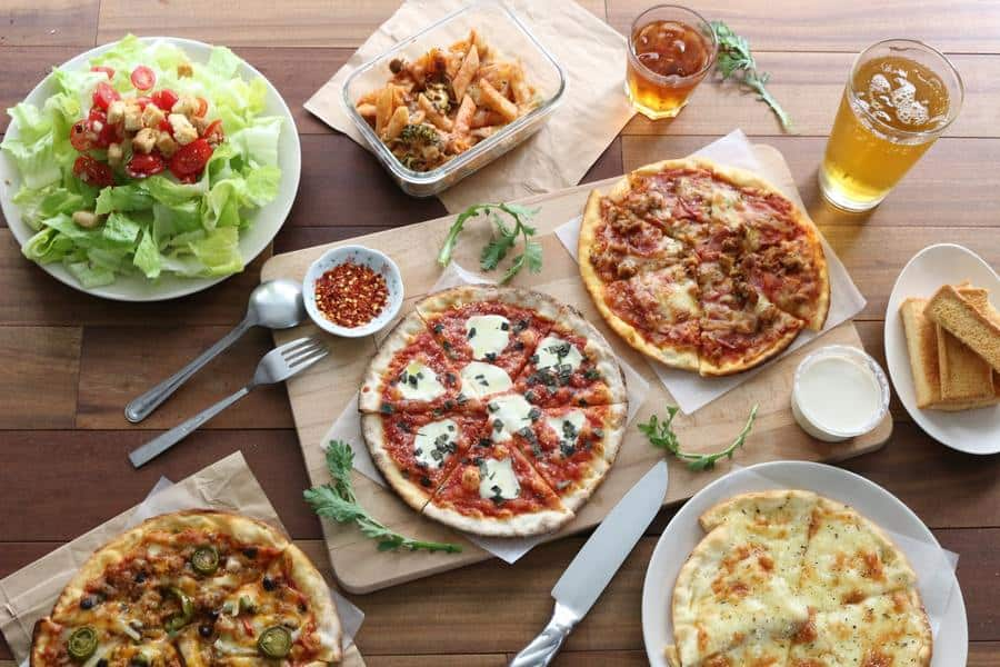 Pizza, salad, beer, and cake