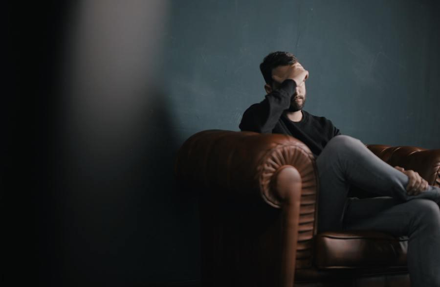 Guy sitting having a headache