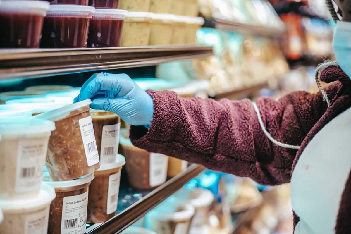 Woman choosing frozen product in supermarket