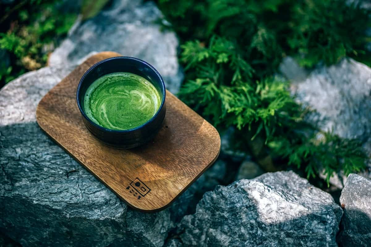 Photo of Matcha Drink on a Wooden Tray